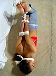 Black girl barefoot & hogtied