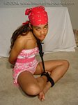 Black girl barefoot & ball-tied