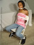 Black girl chair-tied