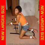 Black girl tied to chair